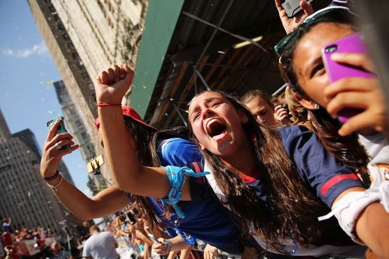 Thousands of fans cheer as the World Cup-winning U.S. women's soccer team make their way up the The Canyon of Heroes along Broadway during a ticker-tape parade on July 10, 2015 in New York City. Following the parade the team celebrated at ceremony at City Hall. According to city records, New York City has hosted 205 parades since 1886 along the Canyon of Heroes, which is located along Broadway between the Battery and City Hall. (Photo by Spencer Platt/Getty Images)