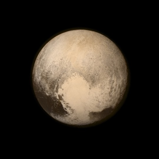 In this handout provided by the NASA, Pluto nearly fills the frame in this image from the Long Range Reconnaissance Imager aboard NASA's New Horizons spacecraft, taken on Monday, when the spacecraft was 476,000 miles from the surface. This is the last and most detailed image sent to Earth before the spacecraft's closest approach to Pluto. (NASA/APL/SwRI via Getty Images)