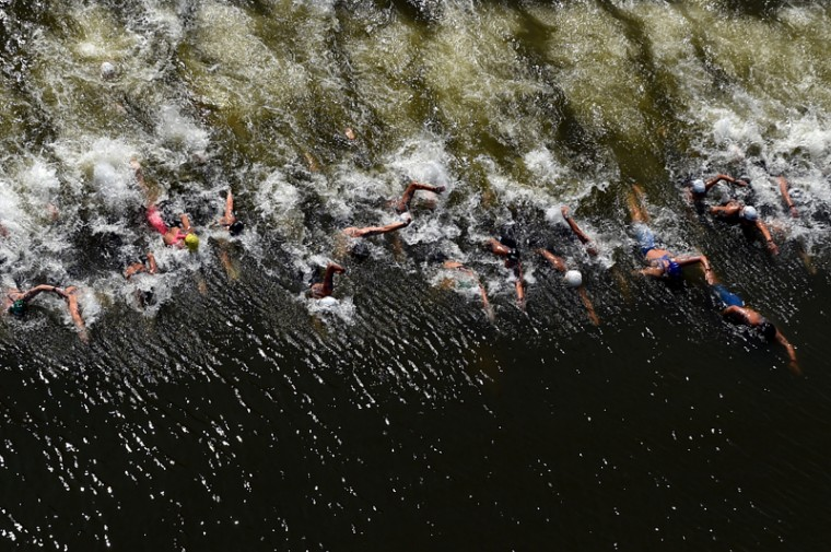 Swimmers dive in at the start of the Women's 10km Open Water Swimming Final on day four of the 16th FINA World Championships at the Kazanka River on July 28, 2015 in Kazan, Russia. (Matthias Hangst/Getty Images)