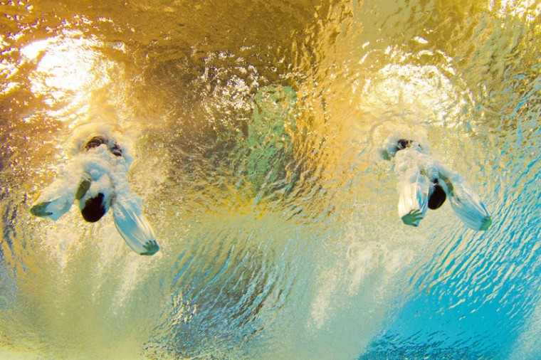 This picture taken with an underwater camera shows silver medalists Jennifer Abel and Pamela ware of Canada competing in the women's synchronized diving 3m springboard diving final at the Pan American games in Toronto on Monday. (DAMIEN MEYERDAMIEN MEYER/AFP/Getty Images)