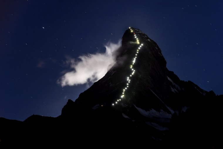 This long exposure taken late on Monday in Zermatt shows lamps illuminating the path of the first climb on the Matterhorn (Mont Cervin) mountain. The resort celebrates this year the 150th anniversary of the iconic Alpine mountain's first climb. For a long time the Matterhorn was considered too difficult to climb but on July 14, 1865, British climber Edward Whymper reached the peak (14,691 feet) as part of a seven-member rope team. During the descent, the front four-member rope team fell to their deaths over the north wall. (FABRICE COFFRINI/AFP/Getty Images)