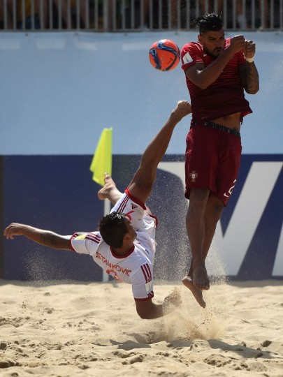 Switzerland's pivot Dejan Stankovic (L) kicks the ball past Portugal's defender Coimbra during the FIFA Beach Soccer World Cup football match Portugal vs Switzerland in Espinho on July 16, 2015. (Francisco Leong/AFP/Getty Images)