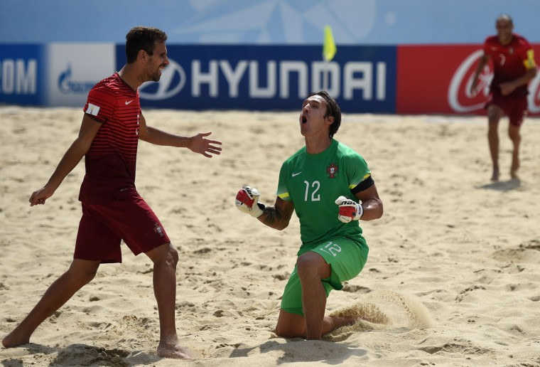 Portugal's goalkeeper Andrade (R) celebrates after scoring a goal during the FIFA Beach Soccer World Cup football match Portugal vs Switzerland in Espinho on July 16, 2015. (Francisco Leong/AFP/Getty Images)