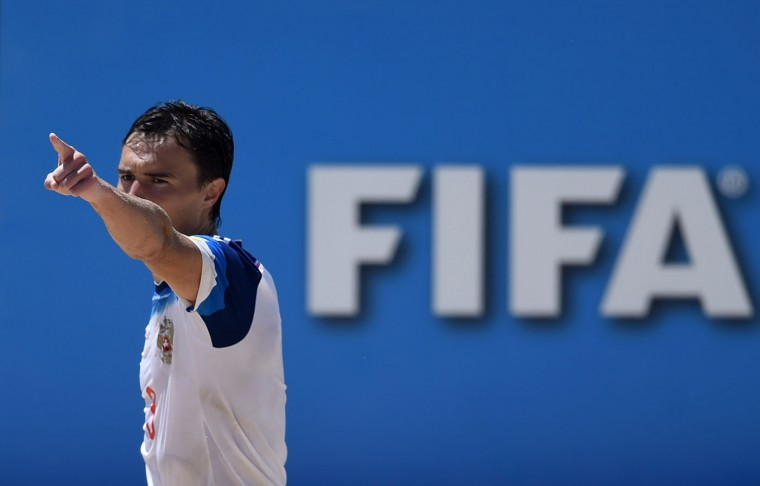 Russia's defender Kirill Romanov celebrates after scoring a goal during the FIFA Beach Soccer World Cup 2015 football match Brazil vs Russia in Espinho on July 16, 2015. (Francisco Leong/AFP/Getty Images)