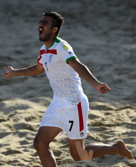 Iran's defender Mehran Morshedi celebrates after scoring a goal during the FIFA Beach Soccer World Cup 2015 football match Iran vs Tahiti in Espinho on July 16, 2015. (Francisco Leong/AFP/Getty Images)