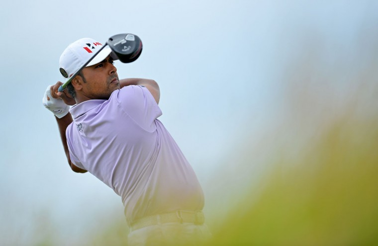 India's Anirban Lahiri watches his drive from the 6th tee during his second round on day two of the 2015 British Open Golf Championship on The Old Course at St Andrews in Scotland, on July 17, 2015. Torrential early rain left its mark on the Old Course at St Andrews as play was suspended for more than three hours and continued to have an effect when play restarted. The delay may mean that the later starters will be unable to complete their second round by day's end. (AFP Photo/Glyn Kirk)