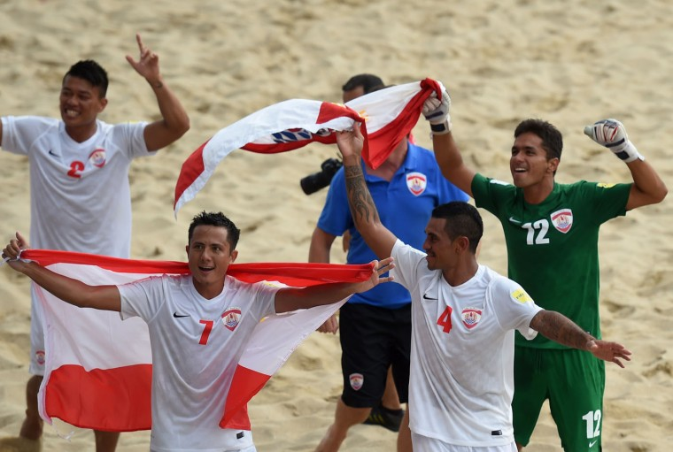 Tahiti's players celebrate at the end of the FIFA Beach Soccer World Cup football match Italy vs Tahiti in Espinho on July 18, 2015. Tahiti won and qualifies for final. (Francisco Leong/AFP/Getty Images)