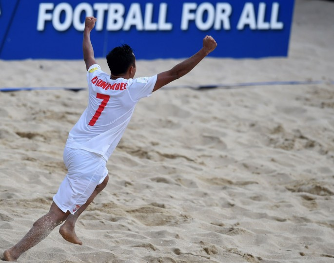 Tahiti's wing Raimana Li Fung Kuee celebrates after scoring the wining goal during the penalty shoot out of the FIFA Beach Soccer World Cup football match Italy vs Tahiti in Espinho on July 18, 2015. Tahiti won and qualified for final. (Francisco Leong/AFP/Getty Images)