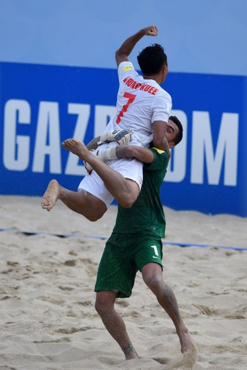 Tahiti's wing Raimana Li Fung Kuee celebrates after scoring the wining goal during the penalty shoot out of the FIFA Beach Soccer World Cup football match Italy vs Tahiti in Espinho on July 18, 2015. Tahiti won and qualified for final. Tahiti's wing Raimana Li Fung Kuee celebrates after scoring the wining goal during the penalty shoot out of the FIFA Beach Soccer World Cup football match Italy vs Tahiti in Espinho on July 18, 2015. Tahiti won and qualified for final. (Francisco Leong/AFP/Getty Images)