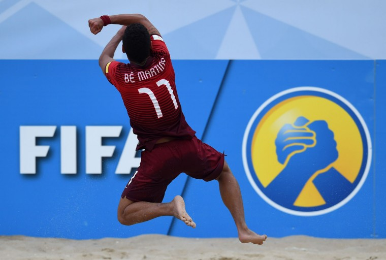 Portugal's wing Be Martins celebrates after scoring a goal during the FIFA Beach Soccer World Cup football match Portugal vs Russia in Espinho on July 18, 2015. Tahiti's wing Raimana Li Fung Kuee celebrates after scoring the wining goal during the penalty shoot out of the FIFA Beach Soccer World Cup football match Italy vs Tahiti in Espinho on July 18, 2015. Tahiti won and qualified for final. Tahiti's wing Raimana Li Fung Kuee celebrates after scoring the wining goal during the penalty shoot out of the FIFA Beach Soccer World Cup football match Italy vs Tahiti in Espinho on July 18, 2015. Tahiti won and qualified for final. (Francisco Leong/AFP/Getty Images)