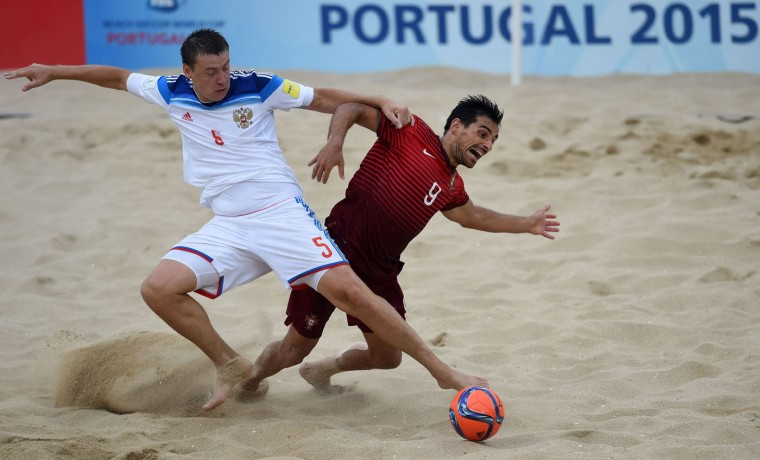 Russia's defender Yury Krasheninnikov (L) vies with Portugal's defender Bruno Novo during the FIFA Beach Soccer World Cup football match Portugal vs Russia in Espinho on July 18, 2015. (Francisco Leong/AFP/Getty Images)