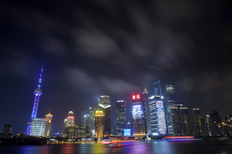 This photo taken on Monday shows clouds above the financial district of Pudong in Shanghai. (JOHANNES EISELE/AFP/Getty Images)