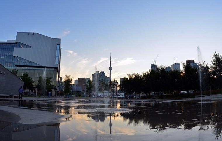 The CN Tower is reflected in water puddles in Toronto, Canada, on Monday during the 2015 Pan American Games. (EVA HAMBACH/AFP/Getty Images)