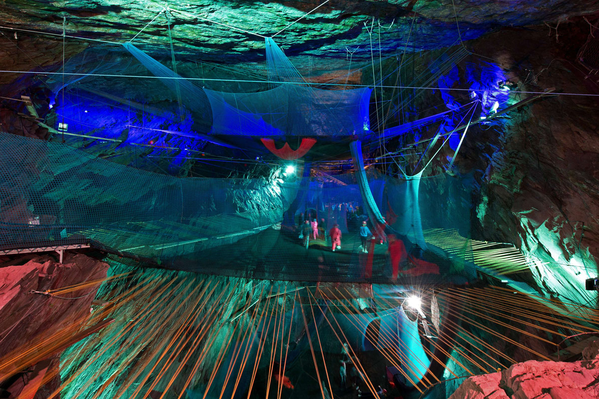 Trampolines, zip lines and slides in an abandoned slate mine
