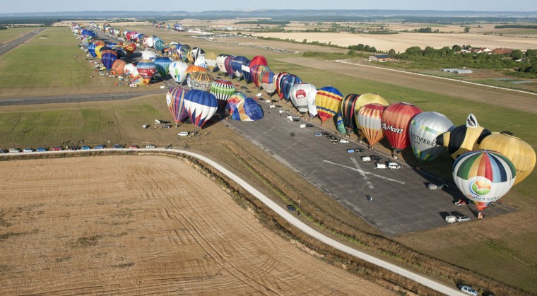 """Hot-air balloons are seen near Chambley-Bussieres airbase, eastern France, on July 26, 2015, on the first day of the international air-balloon meeting """"Lorraine Mondial Air Balloons"""". (JEAN-CHRISTOPHE VERHAEGEN/AFP/Getty Images)"""