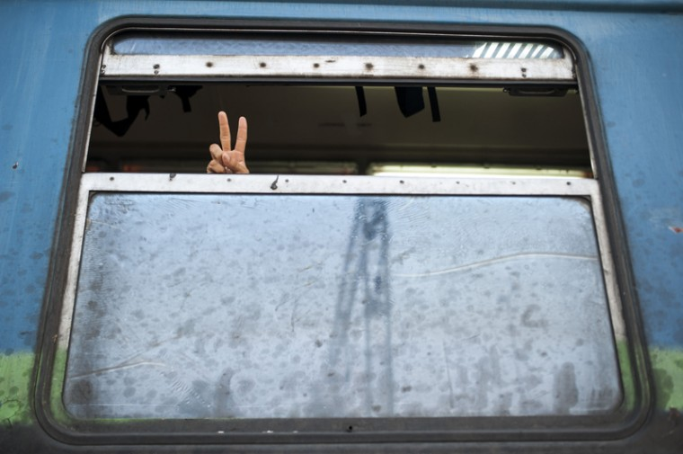 A migrant shows hand victory sign from a train headed to Serbia in the town of Gevgelija, on the Macedonian-Greek border. The migrants, among them children and elderly people are trying to cross Macedonia and Serbia and enter the EU via Hungary. Hungarian authorities started building a fence along the country's border with Serbia earlier this week to halt the migrant influx. (ROBERT ATANASOVSKI/AFP/Getty Images)