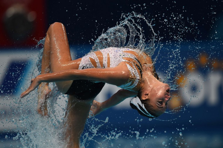 Russia's mixed duet Aleksandr Maltsev (not seen) and Darina Valitova competes in the Mixed duet Free preliminary event during the synchronised swimming competition at the 2015 FINA World Championships in Kazan on July 28, 2015. (CHRISTOPHE SIMON/AFP/Getty Images)