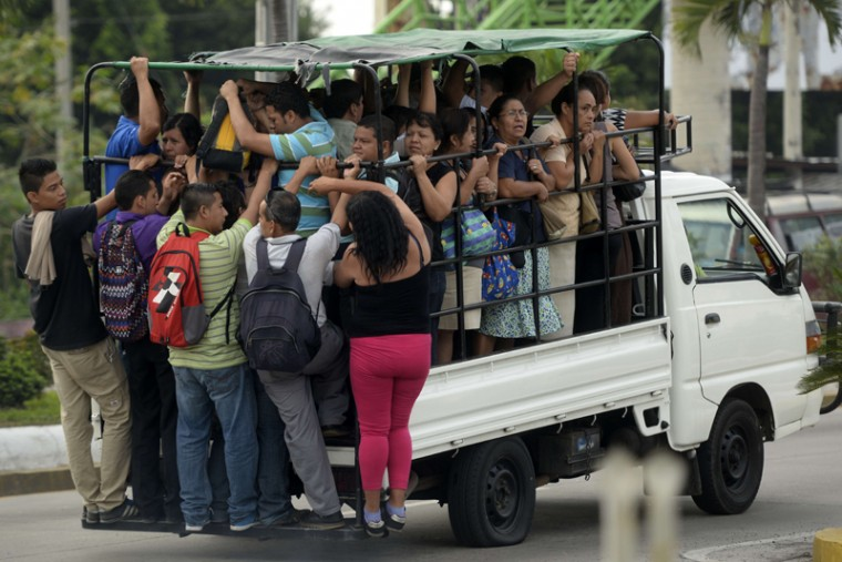 People use different means of transportation to get to work in Apopa, Salvador, on July 28, 2015 during a transport strike over the lack of security in the violence-plagued country. Gangs have shot dead five bus drivers in El Salvador since Sunday. Crime gangs have been trying to pressure the government into recognizing them and negotiating with them on political issues. The Central American nation of six million people is flooded with gangs and has faced a severe spike in violence since 2014 -- 677 homicides were recorded in the country last June with 841 people killed in March. (Marvin RECINOS/AFP/Getty Images)
