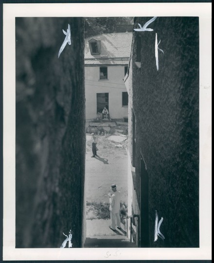 Down an old stairway looking toward the home erected by Col. Edward Lucas, superintendent of Harpers Ferry arsenal about 1850. (A. Aubrey Bodine/Baltimore Sun, 1943)