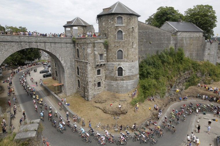 The pack climbs toward the citadel of Namur during the fourth stage of the Tour de France cycling race over 138.9 miles with start in Seraing, Belgium, and finish in Cambrai, France, on Tuesday. (Laurent Cipriani/AP)