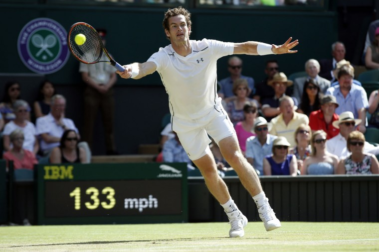 Andy Murray of Britain returns a ball to Ivo Karlovic of Croatia, during their singles match at the All England Lawn Tennis Championships in Wimbledon, London, Monday July 6, 2015. (AP Photo/Alastair Grant)