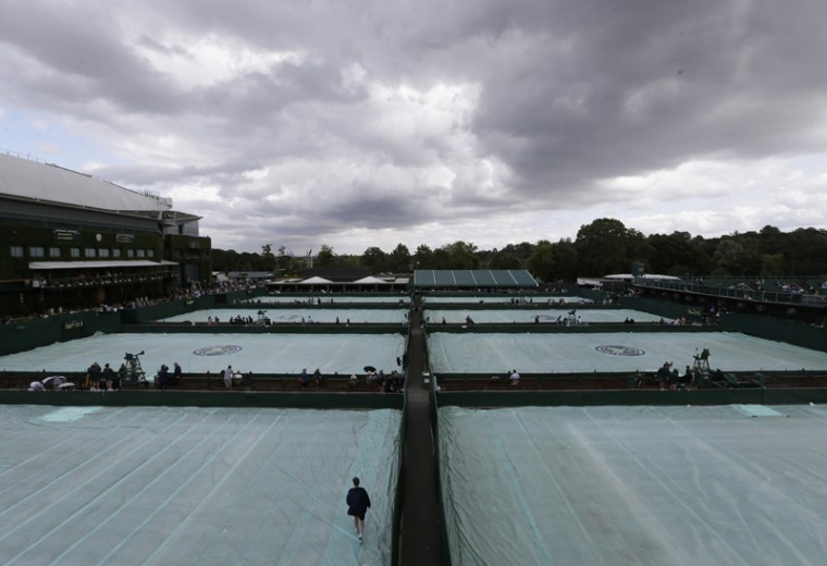 Rain clouds gather over the outside courts, at the All England Lawn Tennis Championships in Wimbledon, London, on Tuesday. (Tim Ireland/AP)
