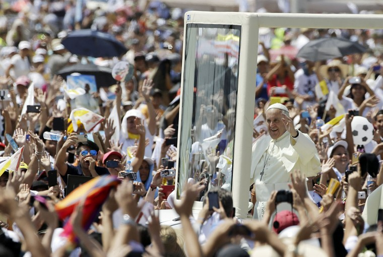 Pope Francis greets the crowd as he makes his way to the main altar in the popemobile to celebrate Mass at Samanes Park in Guayaquil, Ecuador, Monday, July 6, 2015. The Pontiff is visiting Ecuador, Bolivia and Paraguay on the occasion of his Apostolic trip from July 5 to July 12. (AP Photo/Gregorio Borgia)