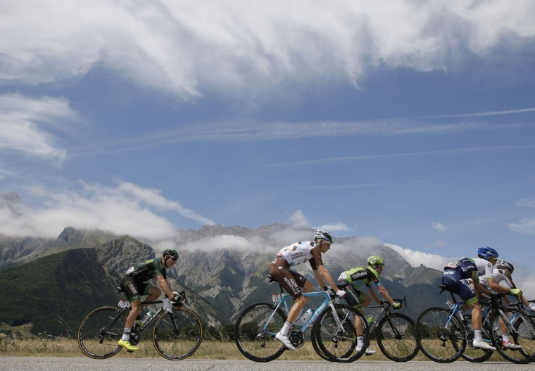 Stage winner Romain Bardet of France, second left, rides with Cyril Gautier of France, left, Andrew Talansky of the U.S., third right, and Britain's Simon Yates, second right, during the eighteenth stage of the Tour de France cycling race over 186.5 kilometers (115.9 miles) with start in Gap and finish in Saint-Jean-de-Maurienne, France, Thursday, July 23, 2015. (AP Photo/Laurent Cipriani) ORG XMIT: PDJ115