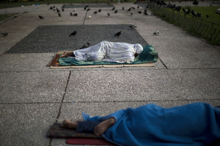"Homeless sleep on the ground in central Athens, Monday, July 6, 2015. Greece's finance minister has resigned following Sunday's referendum in which the majority of voters said ""no"" to more austerity measures in exchange for another financial bailout. (AP Photo/Emilio Morenatti)"
