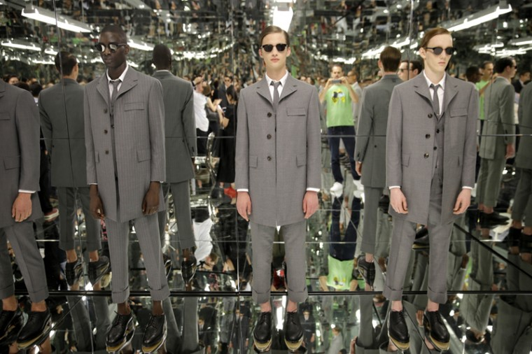 Models stand in a mirrored room during a presentation by Thom Browne at Men's Fashion Week in New York on Tuesday. The inaugural New York Men's Fashion Week runs through Thursday. (Seth Wenig/AP)