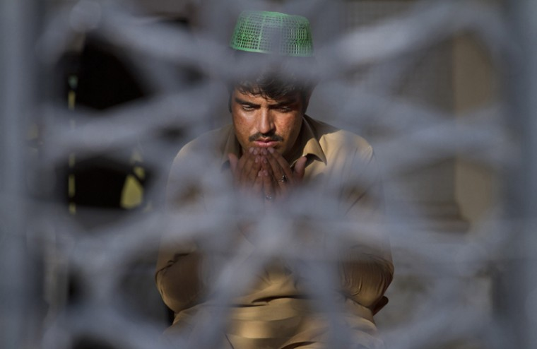 A Pakistani prays at a mosque during the fasting month of Ramadan in Islamabad, Pakistan, on Tuesday. Muslims across the world are observing the holy fasting month of Ramadan, where they refrain from eating, drinking and smoking from dawn to dusk. (Anjum Naveed/AP)