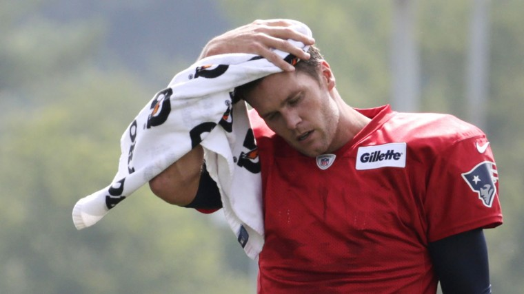 New England Patriots quarterback Tom Brady wipes the sweat from his head during an NFL football training camp in Foxborough, Mass., Thursday, July 30, 2015. (AP Photo/Charles Krupa)
