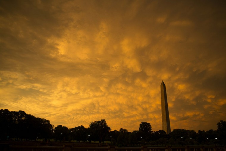 The sun sets on the Washington Monument after a summer storm came through the area, on Tuesday, June 23, 2015, in Washington. Severe weather that pounded the Midwest and spawned tornadoes shifted on Tuesday to the East Coast, where tornado warnings were issued in several states and rainstorms were strong enough to stop train service. (AP Photo/Evan Vucci)