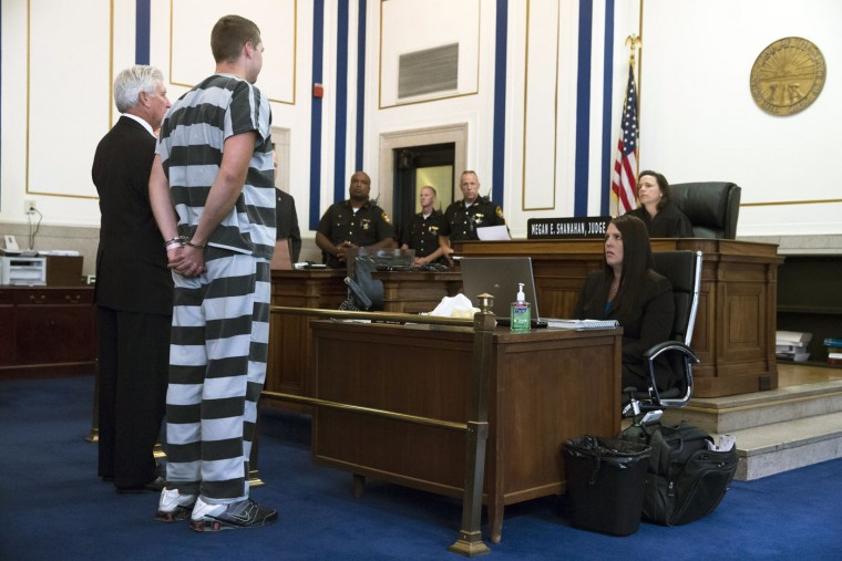 Former University of Cincinnati police officer Ray Tensing, second from left, appears before Judge Megan Shanahan at Hamilton County Courthouse for his arraignment in the shooting death of motorist Samuel DuBose, Thursday, July 30, 2015, in Cincinnati. Tensing pleaded not guilty to charges of murder and involuntary manslaughter. (AP Photo/John Minchillo)