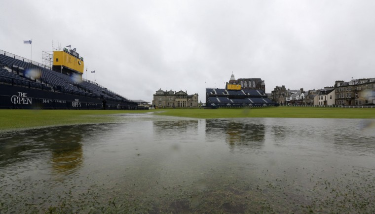 Pools of water collect on the course as play is suspended due to rain during the second round of the British Open Golf Championship at the Old Course, St. Andrews, Scotland, Friday, July 17, 2015. (AP Photo/David J. Phillip)