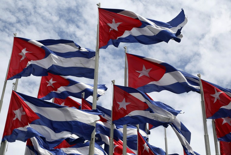 Cuban flags fly beside the United States embassy in Havana, Cuba, Sunday, July 26, 2015, the 62nd anniversary of the 1953 rebel attack led by Fidel and Raul Castro on the Moncada military barracks. The attack is considered the beginning of Fidel Castro¥s revolution that culminated with dictator Fulgencio Batista's ouster.  Desmond Boylan/AP