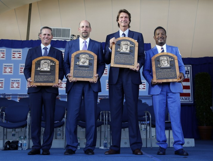 Newly-inducted National Baseball Hall of Famers  from left to right, Craig Biggio, John Smoltz, Randy Johnson and Pedro Martinez hold their plaques after an induction ceremony at the Clark Sports Center on Sunday, July 26, 2015, in Cooperstown, N.Y. Mike Groll/AP