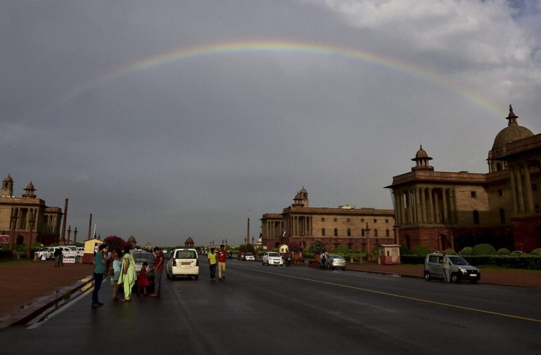 A rainbow appears in the sky above the Raisina Hill that houses India's Presidential Palace and the most important ministries after a rain in New Delhi, India, Monday, July 6, 2015. (Kamal Kishore/Press Trust of India via AP)