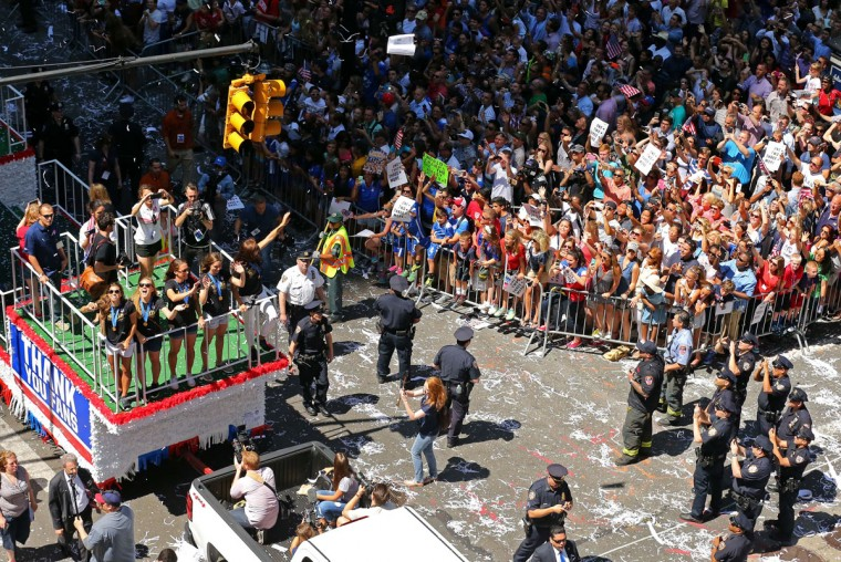 Members of the U.S. women's World Cup championship soccer team ride on a float during a ticker tape parade honoring the team in New York, Friday, July 10, 2015. (AP Photo/Adam Hunger)