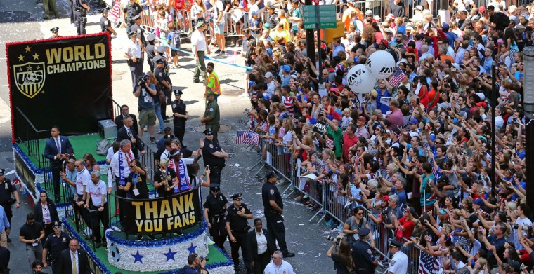 New York City Mayor Bill deBlasio along with members of the U.S. women's World Cup team ride on a float during a ticker tape parade honoring the team in New York, Friday, July 10, 2015. (AP Photo/Adam Hunger)
