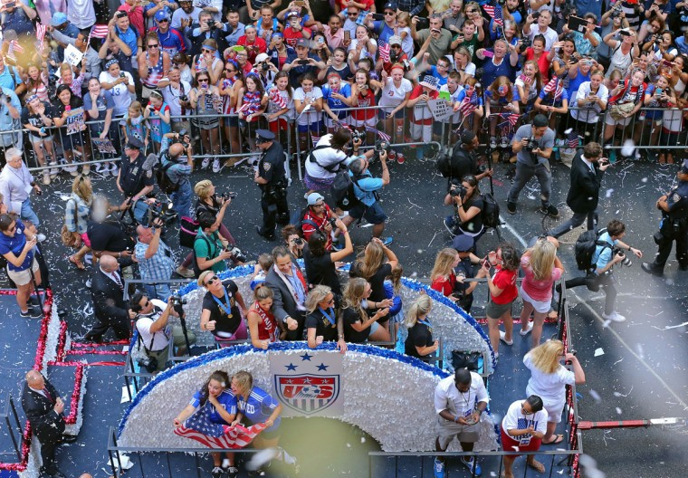 New York Governor Andrew Cuomo, at center on float, gestures during a ticker tape parade for the U.S. women's World Cup soccer team Friday, July 10, 2015, in New York. The U.S. team defeated Japan to win the World Cup on Sunday. (AP Photo/Adam Hunger)
