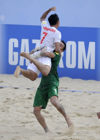 Tahiti's goalkeeperJo and Li Fung Kuee celebrate after their victory over Italy during their FIFA Beach Soccer World Cup semi-final match in Espinho, Portugal, Saturday, July 18, 2015. Tahiti win on penalties 3-1 after a 6-6 draw. (AP Photo/Paulo Duarte)
