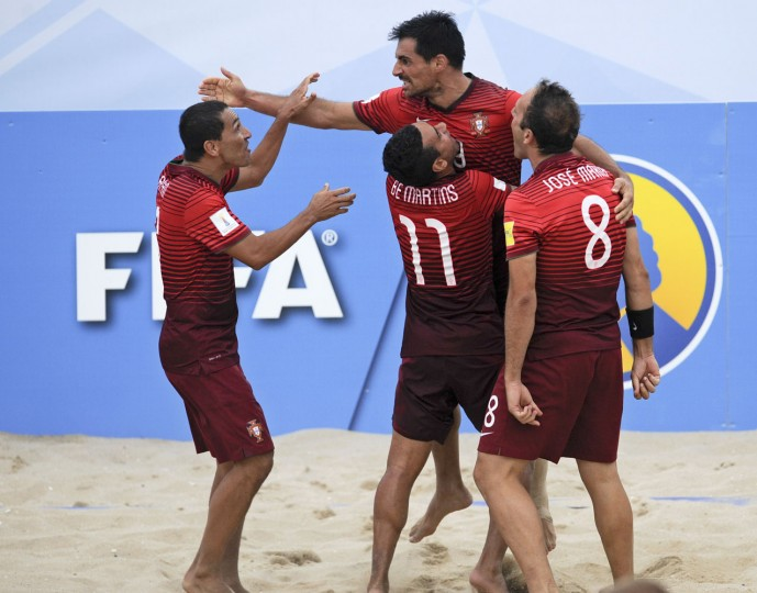 Portugal's players celebrate a goal against Russia during their FIFA Beach Soccer World Cup semi-final match in Espinho, Portugal, Saturday, July 18, 2015. Portugal won 4-2. (AP Photo/Paulo Duarte)
