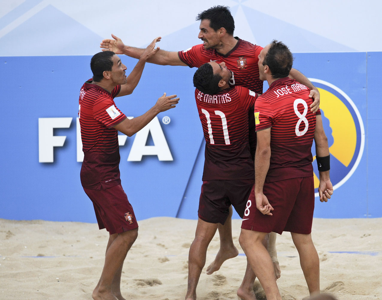Portugals Players Celebrate A Goal Against Russia During Their Fifa Beach Soccer World Cup Semi Final Match In Espinho Portugal Saturday July