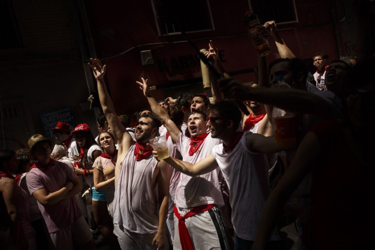 Revelers sing and shout during the launch of the 'Chupinazo' rocket, to celebrate the official opening of the 2015 San Fermin fiestas in Pamplona, Spain, Monday, July 6, 2015. (AP Photo/Daniel Ochoa de Olza)