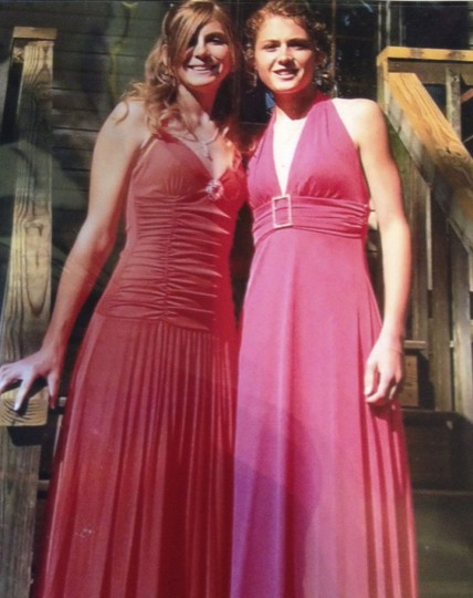 """In this May 2007 photo provided by the family, Atticus Ranck, right, stands with his sister, Kendra Ranck, for a prom photo in Lancaster County, Pa. Having grown up as a girl in Pennsylvania, the 26-year-old came out as a lesbian at 17 and gradually became more """"masculine"""" after he moved to Florida for college. Ranck, who is taking hormones and has had surgery on his chest for the transition, graduated in 2015 with a master's degree in women, gender and sexuality from Florida Atlantic University. (Skip Ranck/Courtesy of Atticus Rank via AP)"""