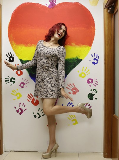 "In this photo taken June 10, 2015, Nikki Rose, 18, who identifies as a transgender female, poses for a photo next to a mural at Survivors Pathway, a non-profit that provides support for LGBTQ youth in Miami. Nikki dropped out of high school where she says she was harassed by her teachers and considers herself fortunate to have support from her mother, saying ""the only thing calming me down from depression is my mother."" Because she has been in fist fights and verbally abused by men on the street, she carries mace, a Taser and a knife. (AP Photo/Lynne Sladky)"