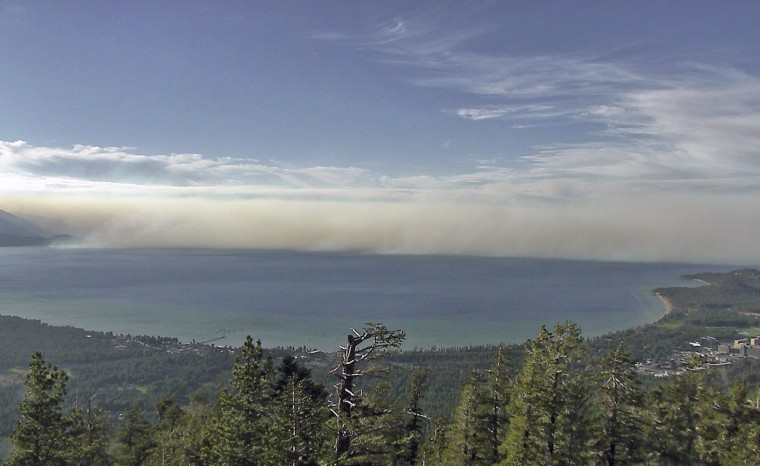 This undated photo provided by the University of Nevada Reno, shows smoke from the King Fire in a view north across Lake Tahoe in South Lake Tahoe, Calif. University researchers are helping federal forest and range managers expand the use of cameras to spot wildfires at Lake Tahoe to the tops of mountains in remote parts of northeast and central Nevada, including one north of Battle Mountain that gave an early warning of a fire more than 100 miles away in Oregon. University of Nevada Reno via AP)
