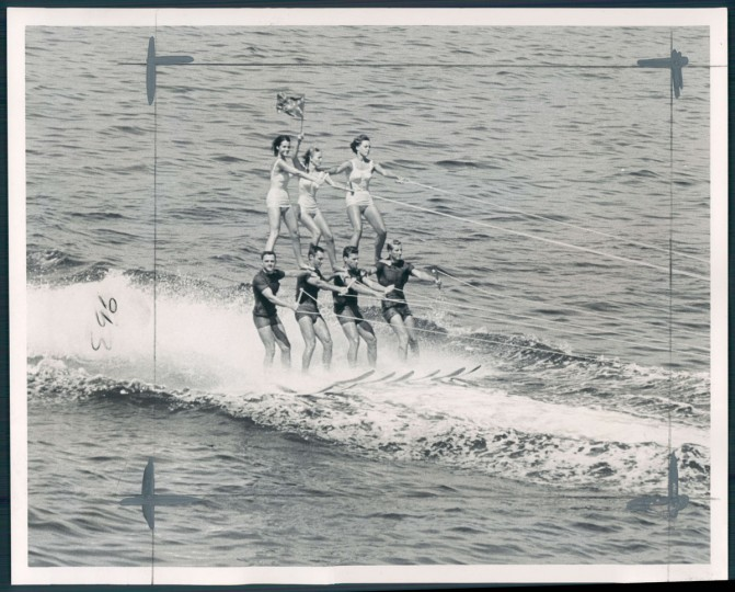 Seven waterskiing enthusiasts from Florida skim past Fort McHenry in one of a series of exhibitions they put on along the route to World's Fair in N.Y., on Aug. 5, 1964. (Baltimore Sun photo)