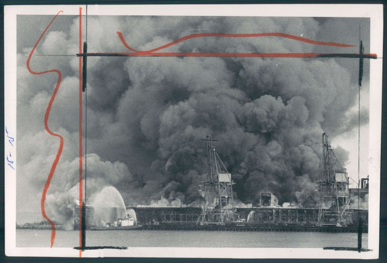 Flames sweep over an unused coal pier on the north side of Locust Point on Oct. 5, 1970. (Baltimore Sun photo by William Hotz)